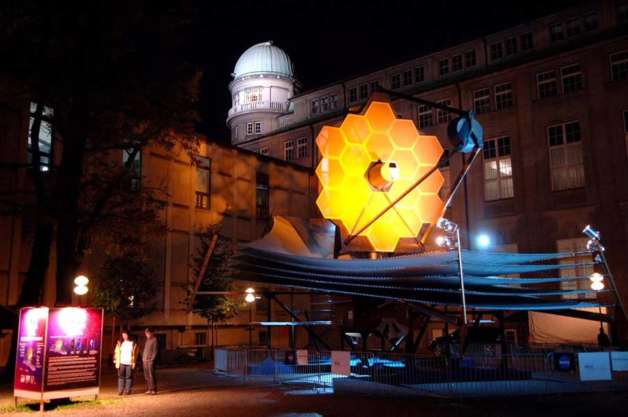 The  Webb telescope full scale model lit up at night in Munich, Germany in  2009