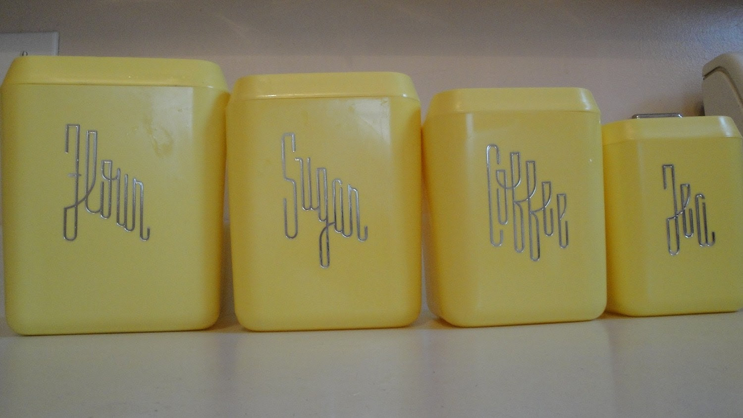 1950s Lustro Ware Yellow Canisters set of 4 with Lids