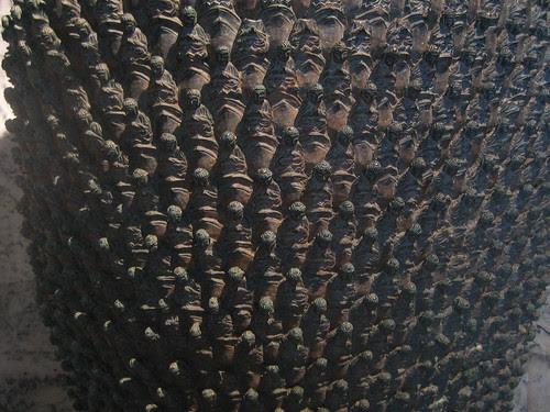 Thousands Buddha Heads Urn _ 1930