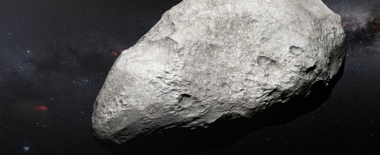 <p>Esta ilustración muestra al asteroide 2004 EW95, el primer asteroide rico en carbono confirmado en el cinturón de Kuiper y una reliquia del sistema solar primordial. / ESO/M. Kornmesser</p>