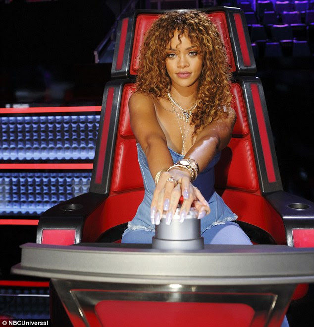 One to impress: With her hand on the buzzer and a determined look in her eye Rihanna was clearly enjoying her stint in the red chair - even if it was only for one episode