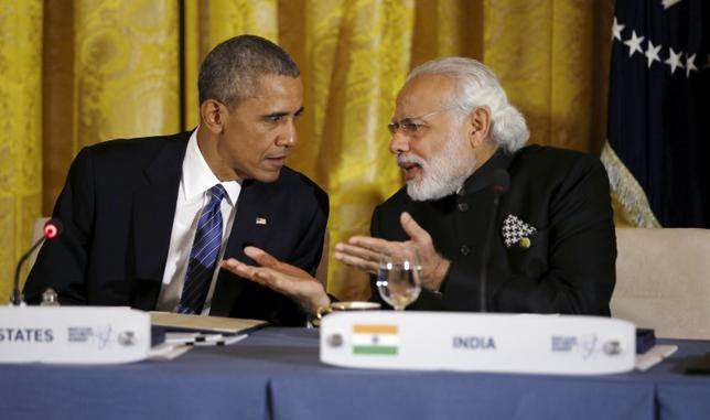 U.S. President Barack Obama talks with Indian Prime Minister Narendra Modi (R) during a working dinner at the White House with heads of delegations attending the Nuclear Security Summit in Washington March 31, 2016. REUTERS/Kevin Lamarque/Files