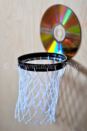 Use a strong adhesive to attach a non-functional CD or DVD as a backboard.