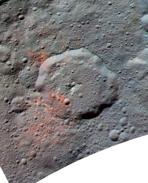 An enhanced image of dwarf planet Ceres...with organics data (shaded in red) taken by NASA's Dawn spacecraft overlaid on the celestial body.