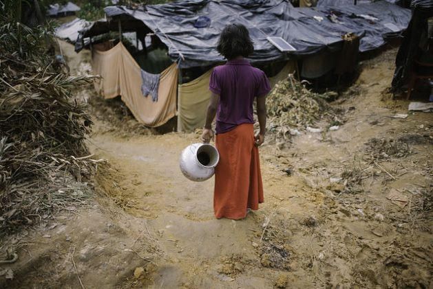 A Rohingya girl goes to fetch water in Balukhali camp, Bangladesh. Credit: Umer Aiman Khan/IPS