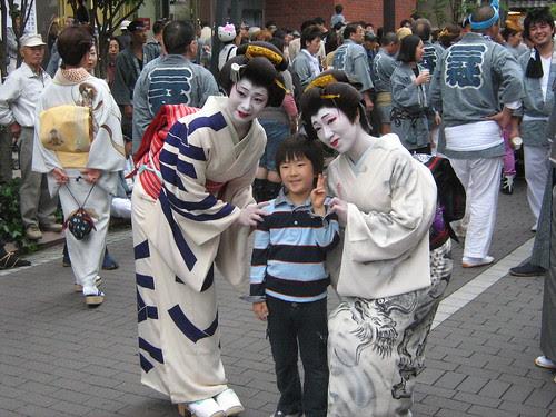 Little boy looks happy with the geisha