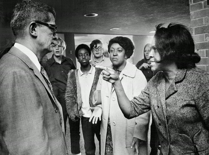 "Description of  SEP 25 1970 - Jack C. Beardshear, George Washington High School Principal, Gets black Parents' viewpoint. ""Who's going to run this school--black students, white students or you?"" she asked as black and white parents gathered in hallway after a meeting about two days of violence that closed the school. (Dave Buresh /The Denver Post)"
