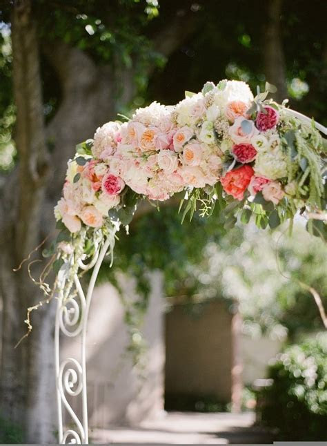 White Arch of Pastel Flowers   Wedding Ceremony Flowers