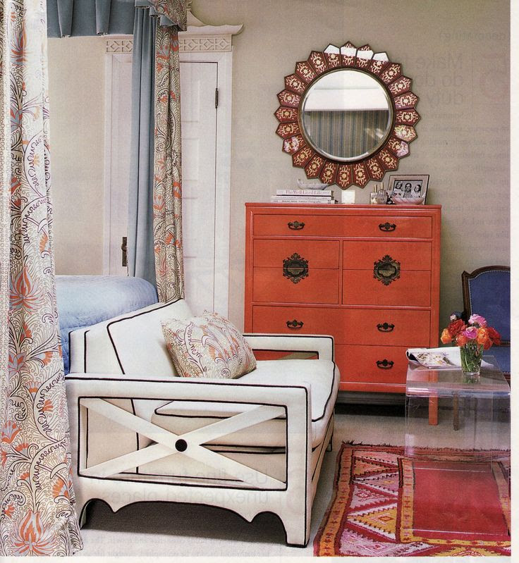 fabulous sitting area at the foot of the bed.  I love the lucite console, the rug and the color of hte dresser.  Not to mention the bench and mirror and little blue chair.  Okay, I love it all.