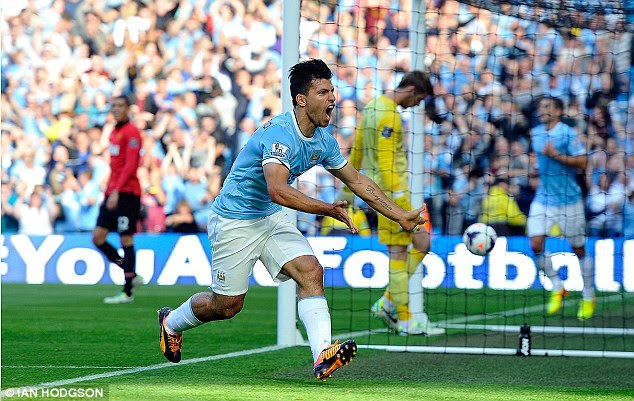 Perfect start: Aguero celebrates scoring the first goal in the derby