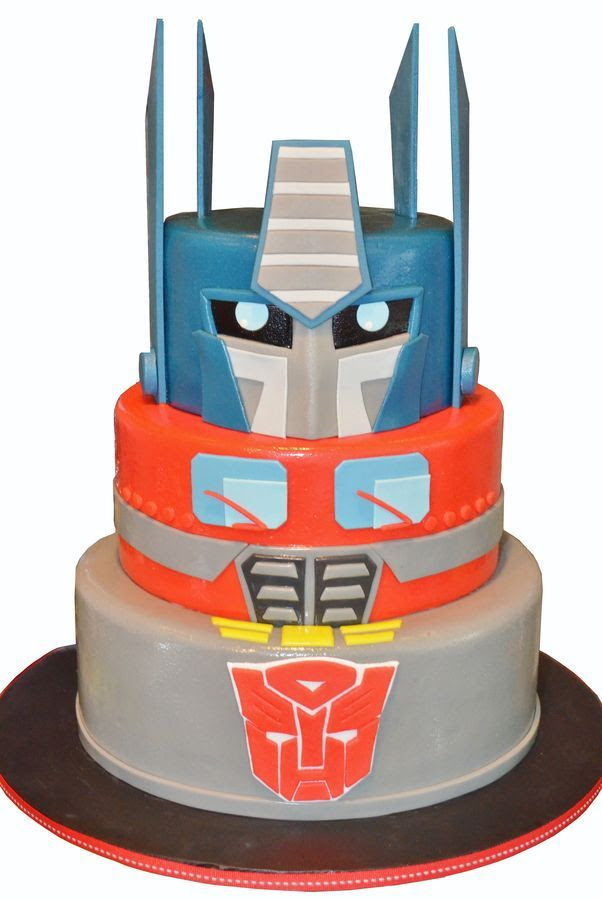 Optimus Prime birthday cake for a seven year old.   Thank you to the many transformer cakes for inspiration especially Tuff Cookie cakes by Sylvia