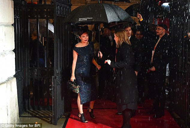 A soggy arrival: Anna Friel braved the pouring rain to make her way into the ceremony