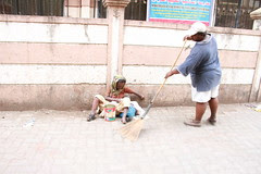 Sweeping Away the Pain of Living on The Streets by firoze shakir photographerno1