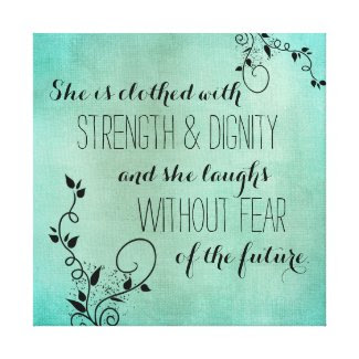She is clothed with strength and dignity scripture stretched canvas print