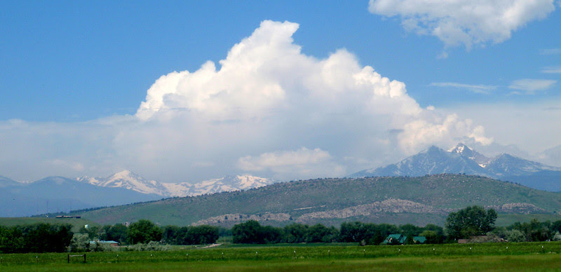 Afternoon storms gathering forces over the Front Range.  14,255-foot Longs Peak rising center right in photo.