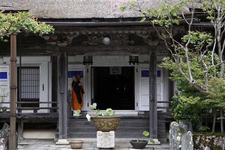 Buddhist monks walk at a temple in Koyasan in Koya, Wakayama prefecture, June 25, 2013. REUTERS-Hideyuki Sano