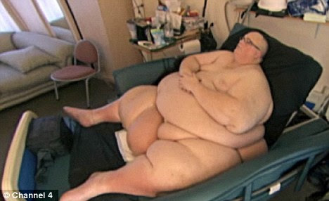 Fattest man: Paul Mason received a vital operation after ballooning to nearly 70 stone but plans to sue the NHS for ignoring his pleas for help
