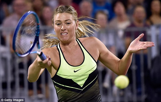 Maria Sharapova plays a forehand during the World Team Tennis Smash Hits charity event