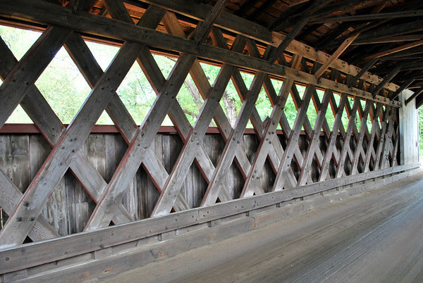 A view inside the Lattice Truss design Silk Road Covered Bridge in Bennington, Vermont.