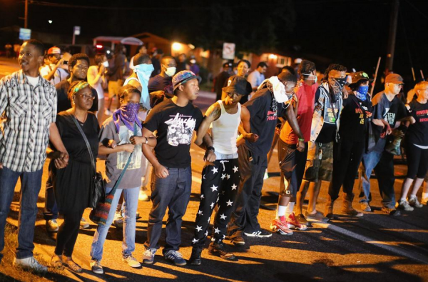 Protests in Ferguson, MO after an unarmed black teenager, Michael Brown, was shot and killed by Ferguson police. Photo credit: Southern Poverty Law Center
