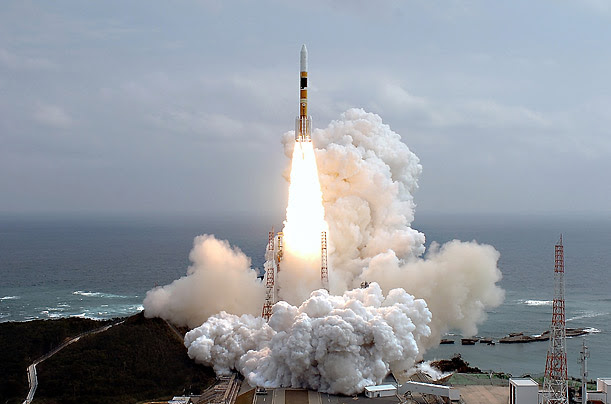 An H2-A rocket lifts off from a launching pad at the Tanegashima Space Center in Kagoshima Prefecture, Japan.