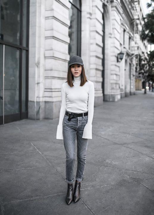 Le Fashion Blog Wool Baseball Hat White Fluted Sleeve Turtleneck Grey Jeans Black Heeled Boots Via Tsangtastic