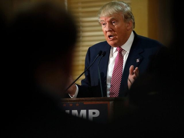 Republican presidential candidate Donald Trump speaks with members of the media during a news conference Monday, Feb. 15, 2016, in Hanahan, S.C. ()