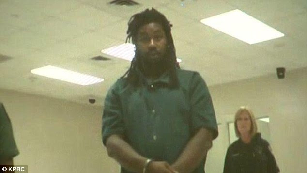 Kidnapping suspect Jesse 'LJ' Matthew, 32, stood in green prison overalls with his hands cuffed in front of him as charges were read in Galveston on Thursday