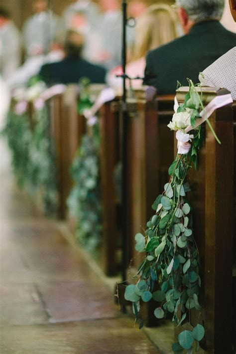 Eucalyptus leaves, white roses, pink ribbon, wedding
