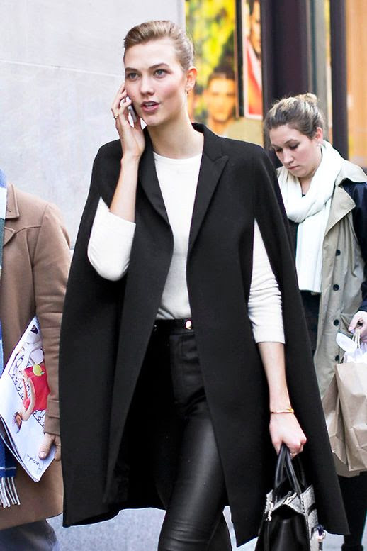 LE FASHION BLOG MODEL OFF DUTY KARLIE KLOSS NEW YORK FASHION WEEK BLACK CAPE COAT WHITE KNIT SWEATER HIGH WAIST CROPPED LEATHER PANTS BLACK WHITE PRINT SATCHEL BAG MODEL STYLE VIA ALTAMIRA 1 photo LEFASHIONBLOGMODELOFFDUTYKARLIEKLOSSCAPECOATLEATHER1.jpg