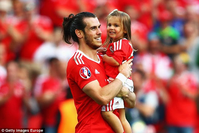 Bale celebrated Wales' victory over Northern Ireland at Euro 2016 with his young daughterAlba Violet