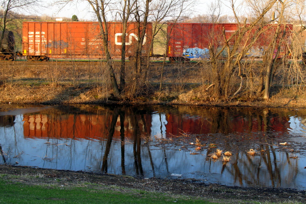 Reflection of a train in water as it passes by.