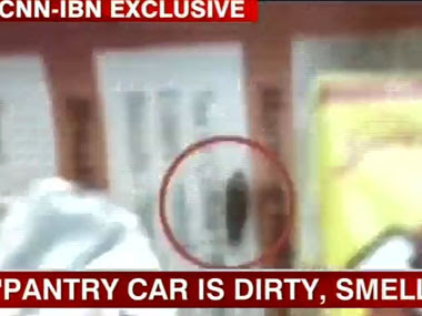 Video grab of a passenger video accessed by CNN-IBN showing cockroach on food served on Shatabdi. IBNLive.