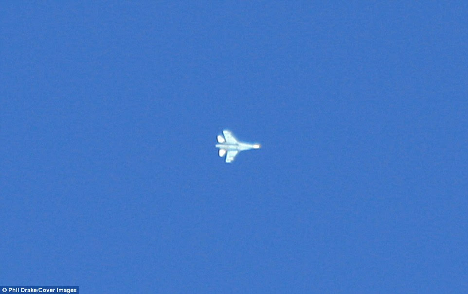 Air Traffic Controller Phil Drake said this aircraft was the Russian-built Sukoi SU-27P Flanker-B with Soviet style camouflague