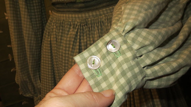 mother of pearl buttons on sleeves
