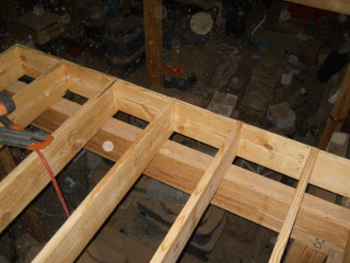 Full 2x10 Blocks Between Joists Over Second Beam