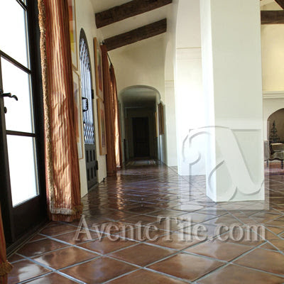 The Spanish Floor tile layout makes this hall seem quite grand.