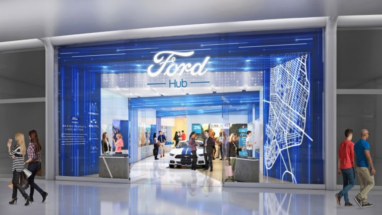 A Ford stall with people inside looking at a car