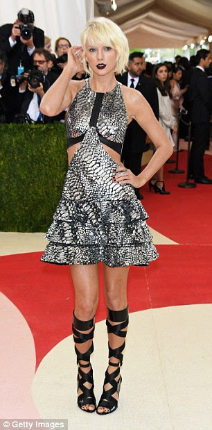 From bronze mini dresses and metallic skirts to gunmetal gown, Taylor Swift loves to sparkle