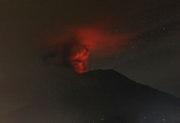 Mount Agung volcano is seen erupting from Glumpang village, Karangasem.