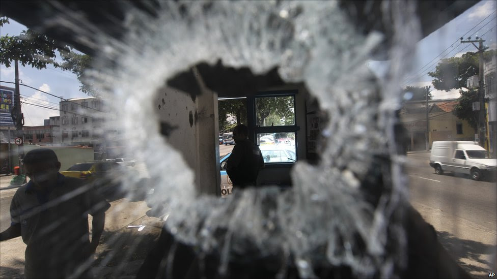 A bullet hole in the window of a small police station in the Del Castilho neighbourhood in Rio de Janeiro, Brazil,