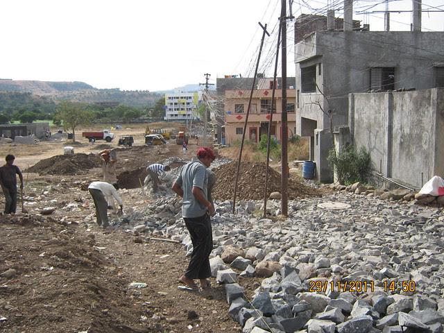 Under construction 21 feet wide tar road to Urbangram Kirkatwadi, A 2 BHK Flat for Rs. 25 Lakhs on Sinhagad Road, Pune 411 024