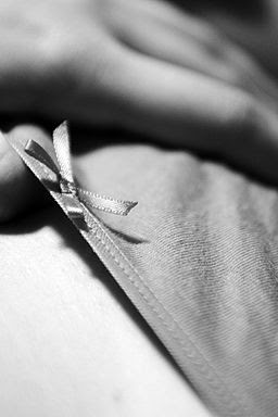 Female with hands on its panties in B&W