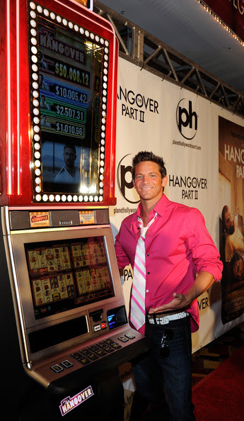 "Jeff Timmons Singer Jeff Timmons poses next to a new ""The Hangover"" slot machine by International Game Technology as he arrives at the Las Vegas premiere of the Warner Bros. Pictures movie, ""The Hangover Part II"" at the Planet Hollywood Resort & Casino May 21, 2011 in Las Vegas, Nevada. The film opens nationwide in the United States on May 26."