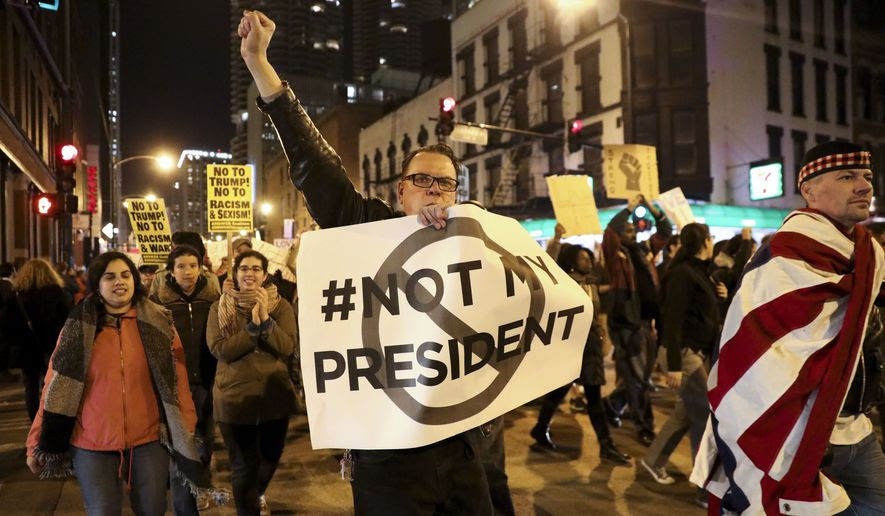 Protesters march in Chicago on Wednesday to express their disapproval of the election of Donald Trump. (Chicago Tribune via Associated Press)