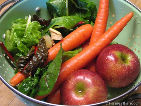 Making homemade carrot, apple, Swiss chard juice with fresh ginger - FarmgirlFare.com