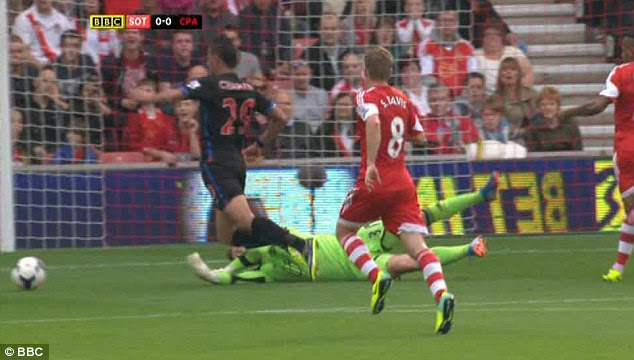 Dive? Chamakh was booked for going down from this goalscoring opportunity