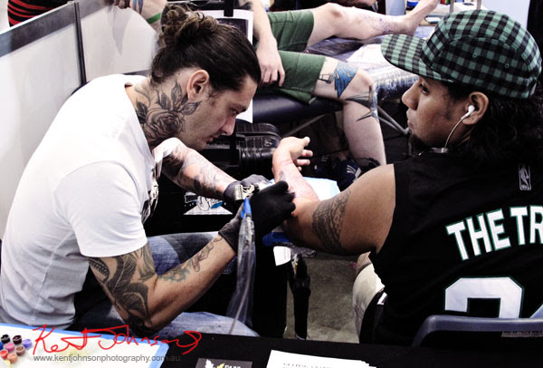Tattooing in progress at the 2012 Sydney Tattoo & Body Art Expo by Kent Johnson