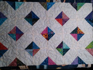 Scraps from Briar Rose quilt made into a table runner.