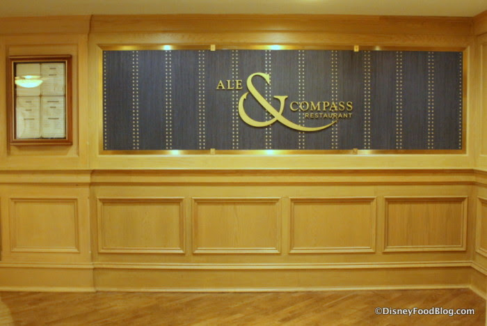 Ale & Compass Restaurant sign by the entrance